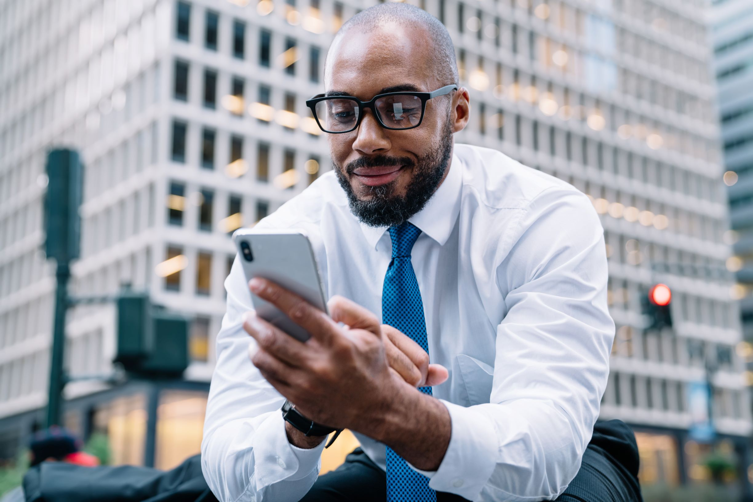 attorney is pleased to discover a new live call coming to his phone to help find a new client