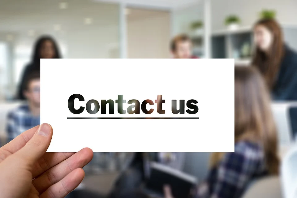 """Close-up view of a """"contact us"""" sign."""