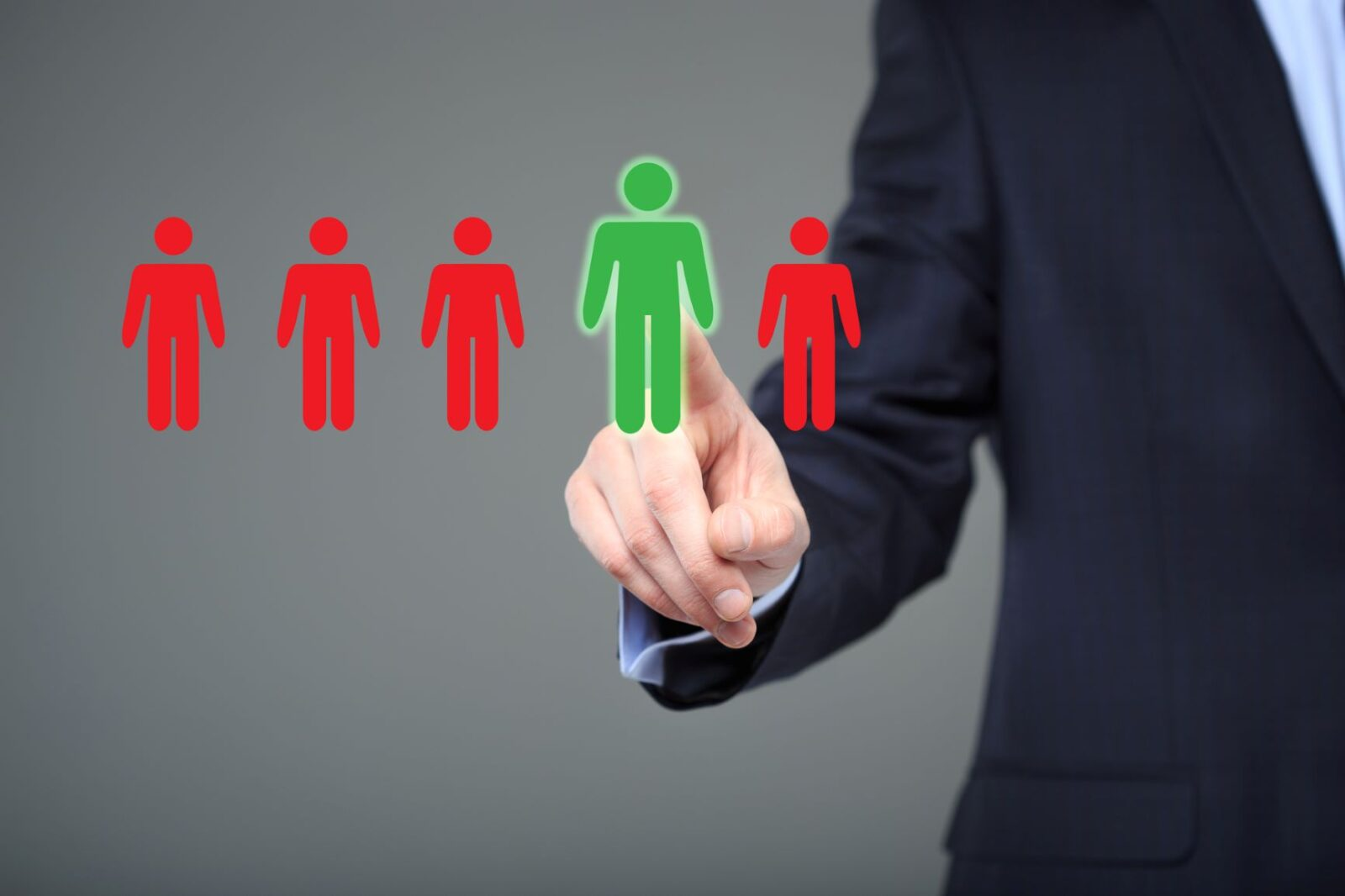 A row of five animated human icons, four the same size and colored red, while one is being indicated by a person in a business suit, and appears larger and colored green.